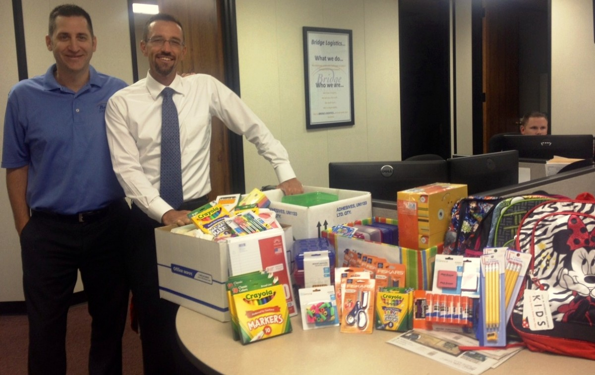 Larry Warner Jr  School supplies drive-August 2013- Stephenson & Warner Inc.,